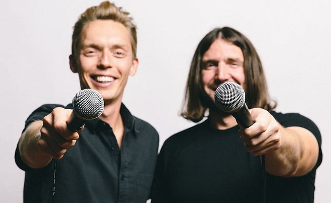 Two Guys Holding Microphones