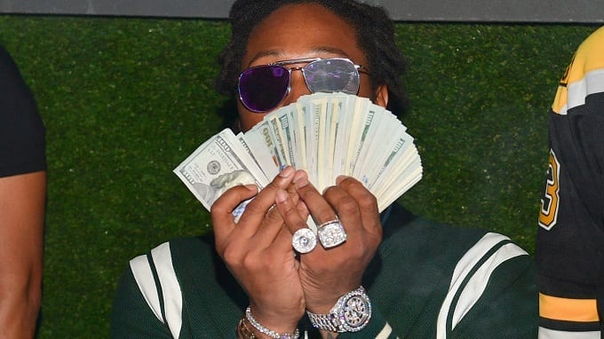 Man With Dollars In Hands